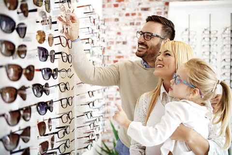 Family looking at eye glass options